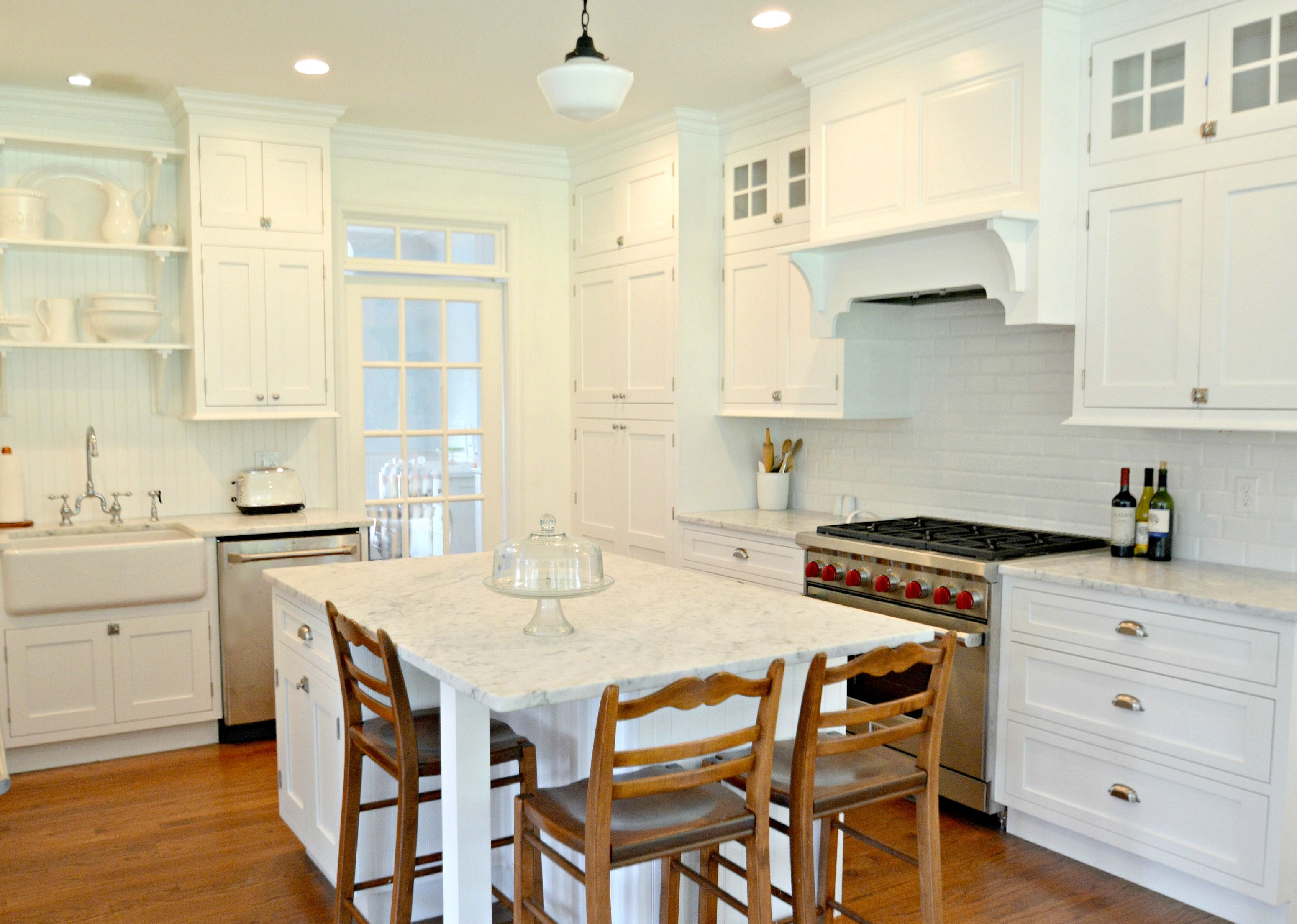 White Kitchen With Carrara Marble Counters And Wood Floors Designed And Built By Bryan Construction Inc Www Kitchen Design Kitchen Remodel Home Construction