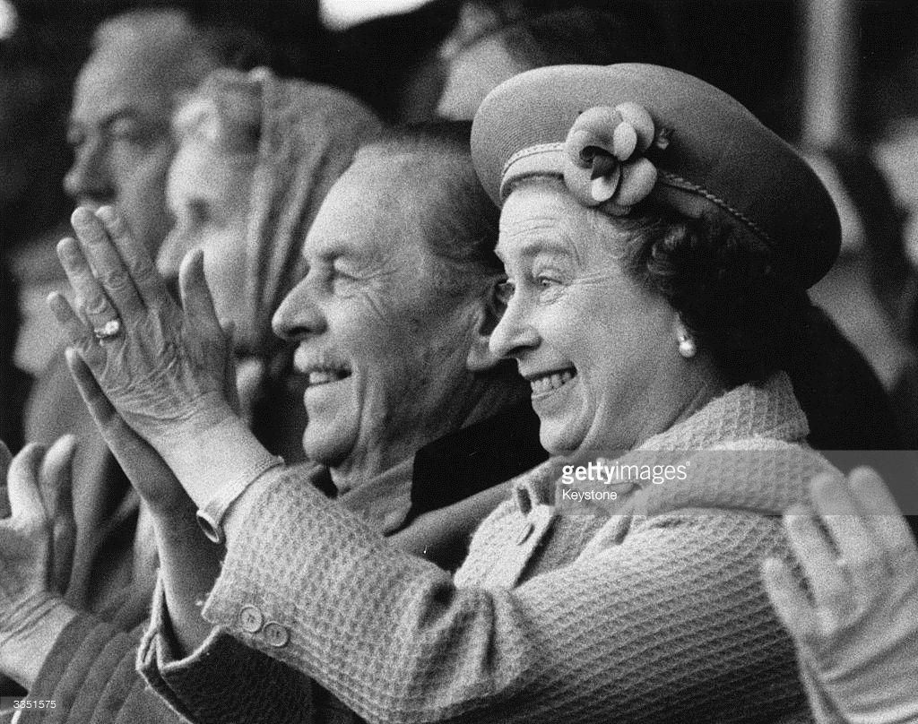 Queen Elizabeth II applauds enthusiastically as her