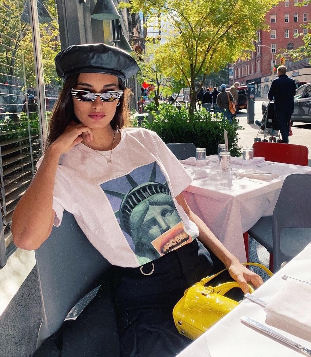 3f7f994dfdd4 Gizele Oliveira spotted in our  Hey Reilly x Marc Jacobs T-Shirt and Signature  Mini Cat-Eye Sunglasses