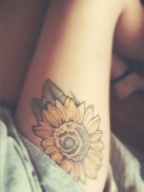I love this sunflower tattoo. Its the only flower tattoo that I feel doesnt look too common. I usually dont like colour tattoos but this is just enough! style