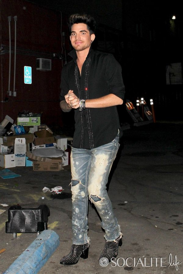 Adam Lambert gives up a smile as he leaves Hooray Henry's