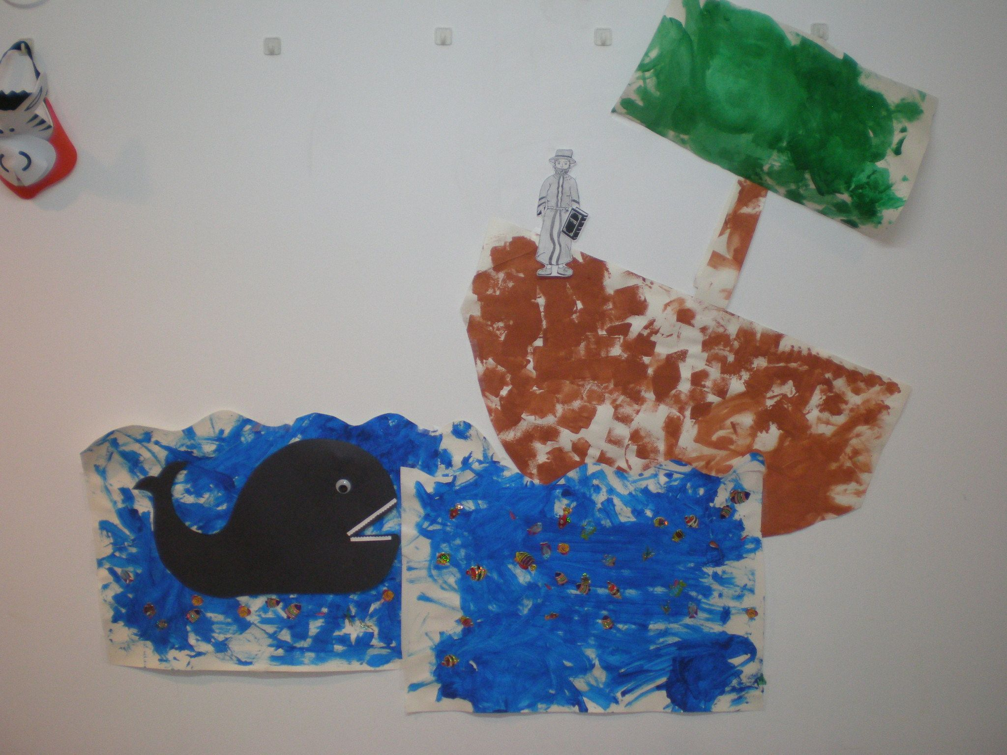 Wall art: Yom Kippur - Iona & the whale.  the children painted the boat & water. They put fish stickers. Iona is taped to the wall so we were able to move him around and even put him inside the whale! kids loved it!