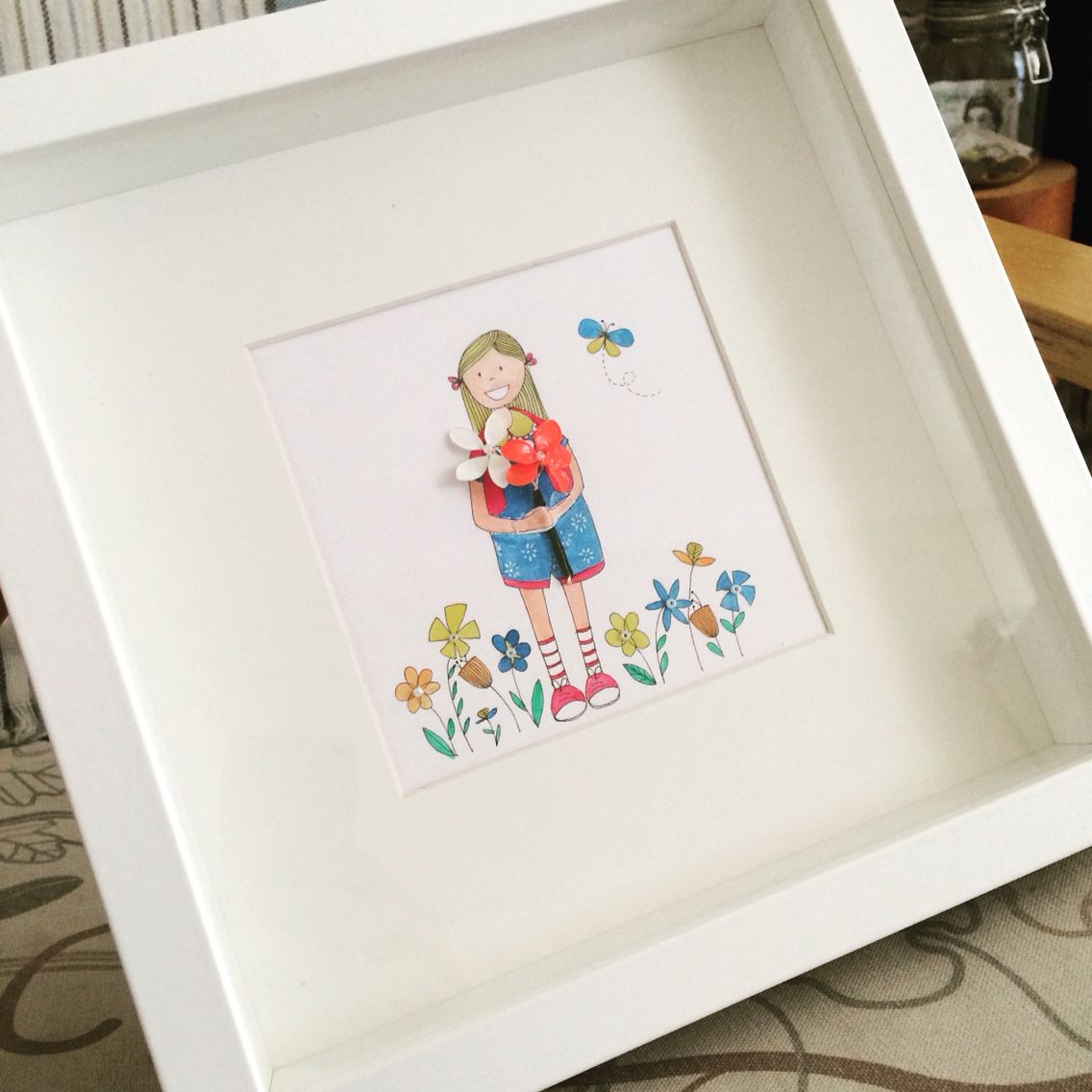 Illustrations of a little girl holding handmade flowers made by https://m.facebook.com/Daisy.BowDesign