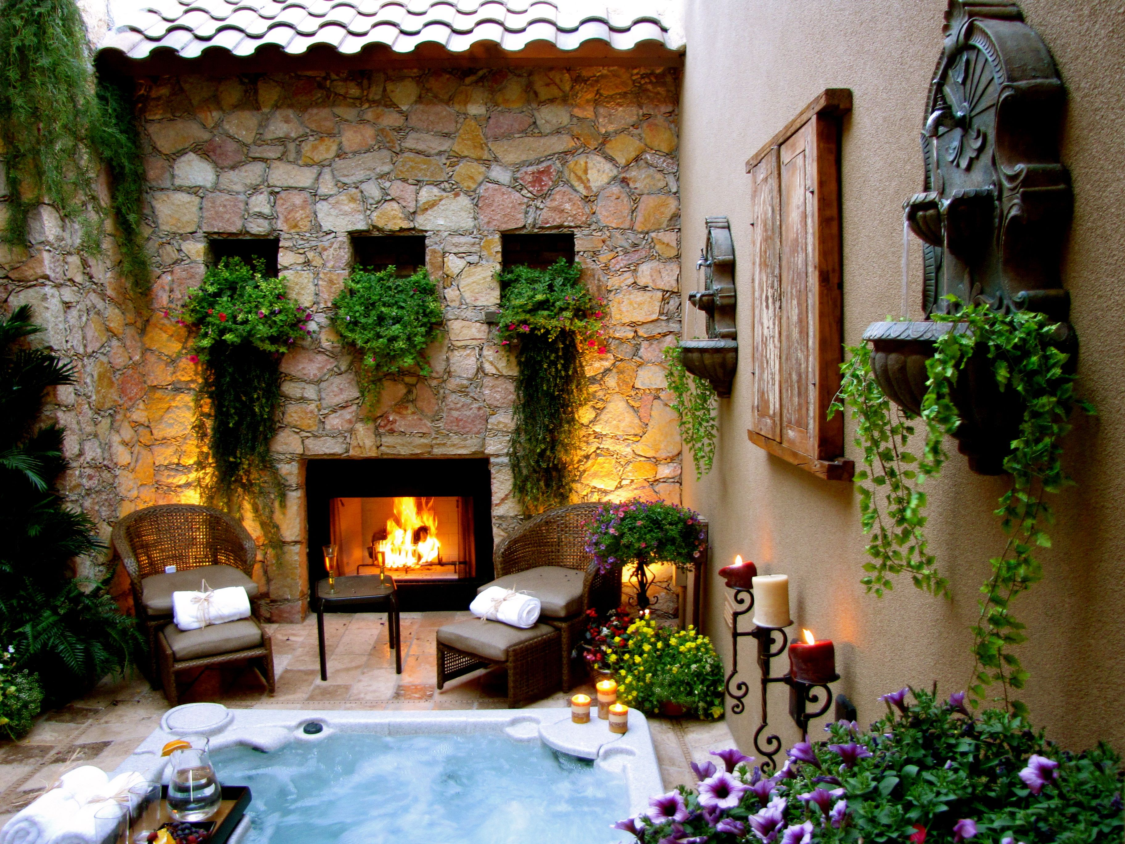 Open Air Courtyard With Hot Tub In Center And Fireplace