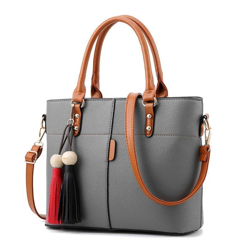 Photo of Women High Quality Faux-Leather Bag with Brown Grab Handles and Black-Red Tassels
