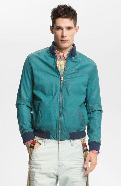 Eugene's teal leather jacket that he wears the first time they meet - Chapter 1