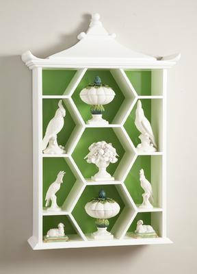 pagoda curio shelf. white and green. collection.