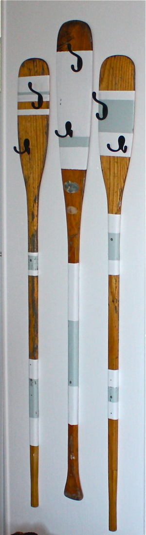 paddle coat rack made from salvaged oars for a cottage renovation... whole before and after post at cynthiaweber.com