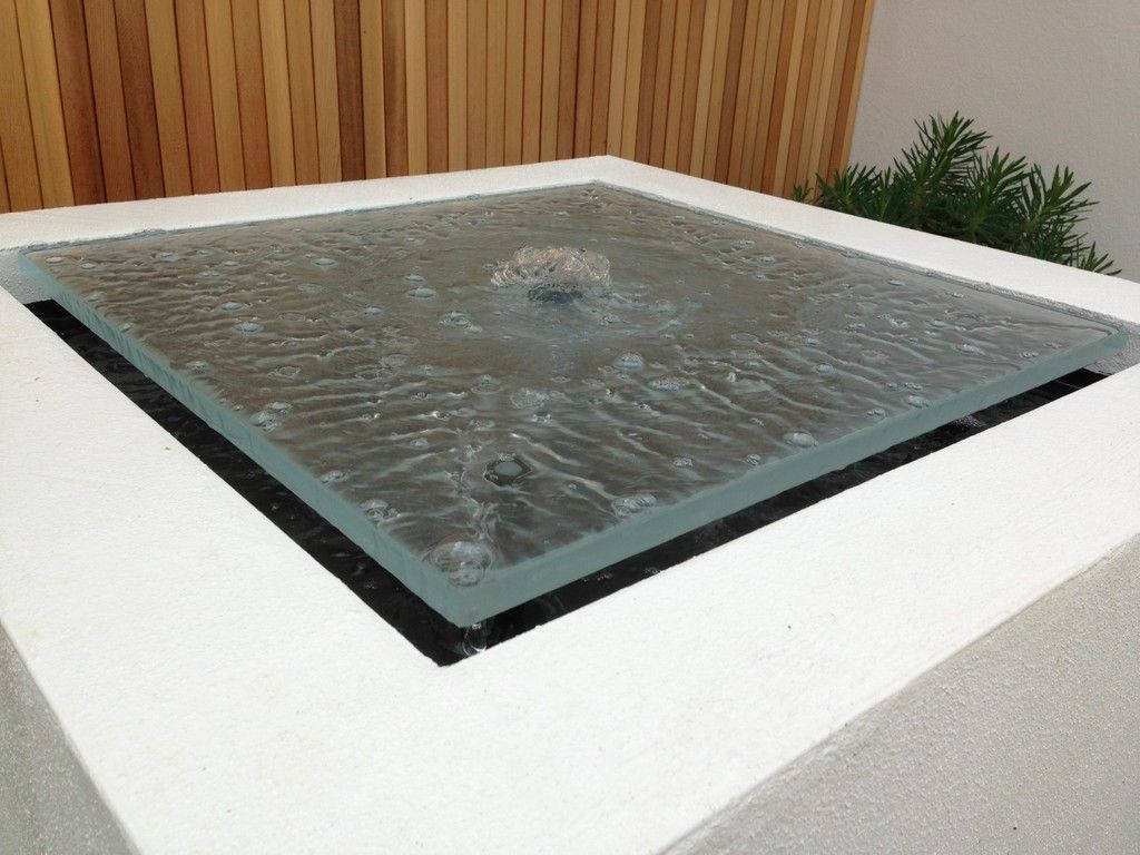 glass sheet contemporary water feature set within white cube