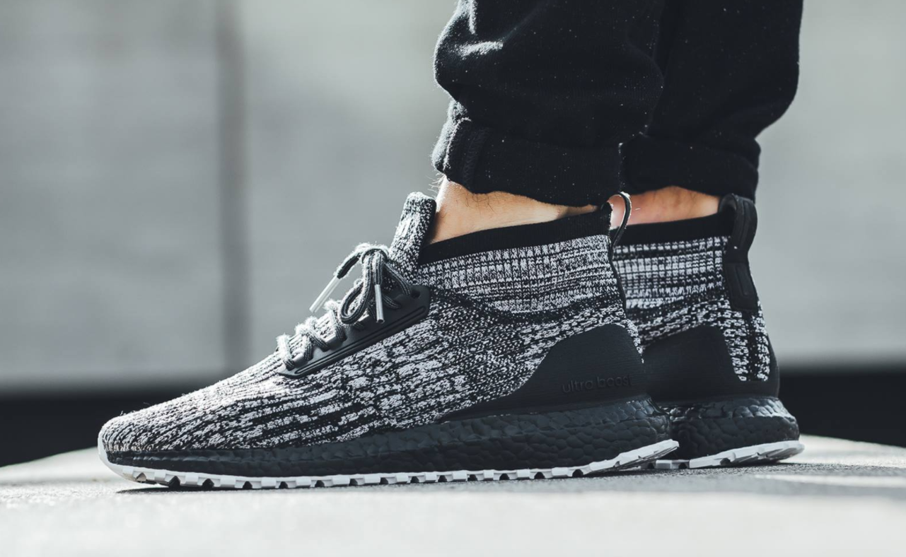 91859aece A lifestyle look at the adidas Ultra Boost ATR Mid Oreo Black Boost is  featured and