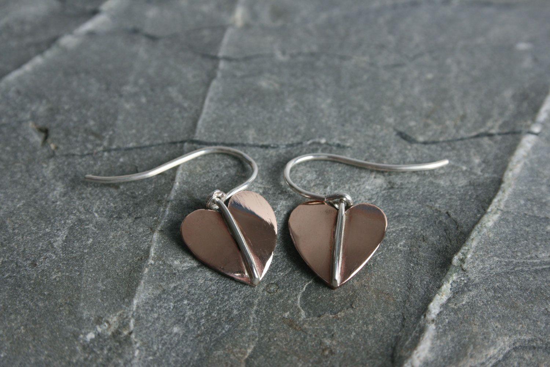 Handmade bronze and sterling silver earrings. Supplied with hook fittings.   #bronze #earrings #leaf #silver #jewellery #cornwall #uk #gb #westcountry #devon #england #silversmith #pretty #jeweller #jewellers #handmadejewellery #handmade