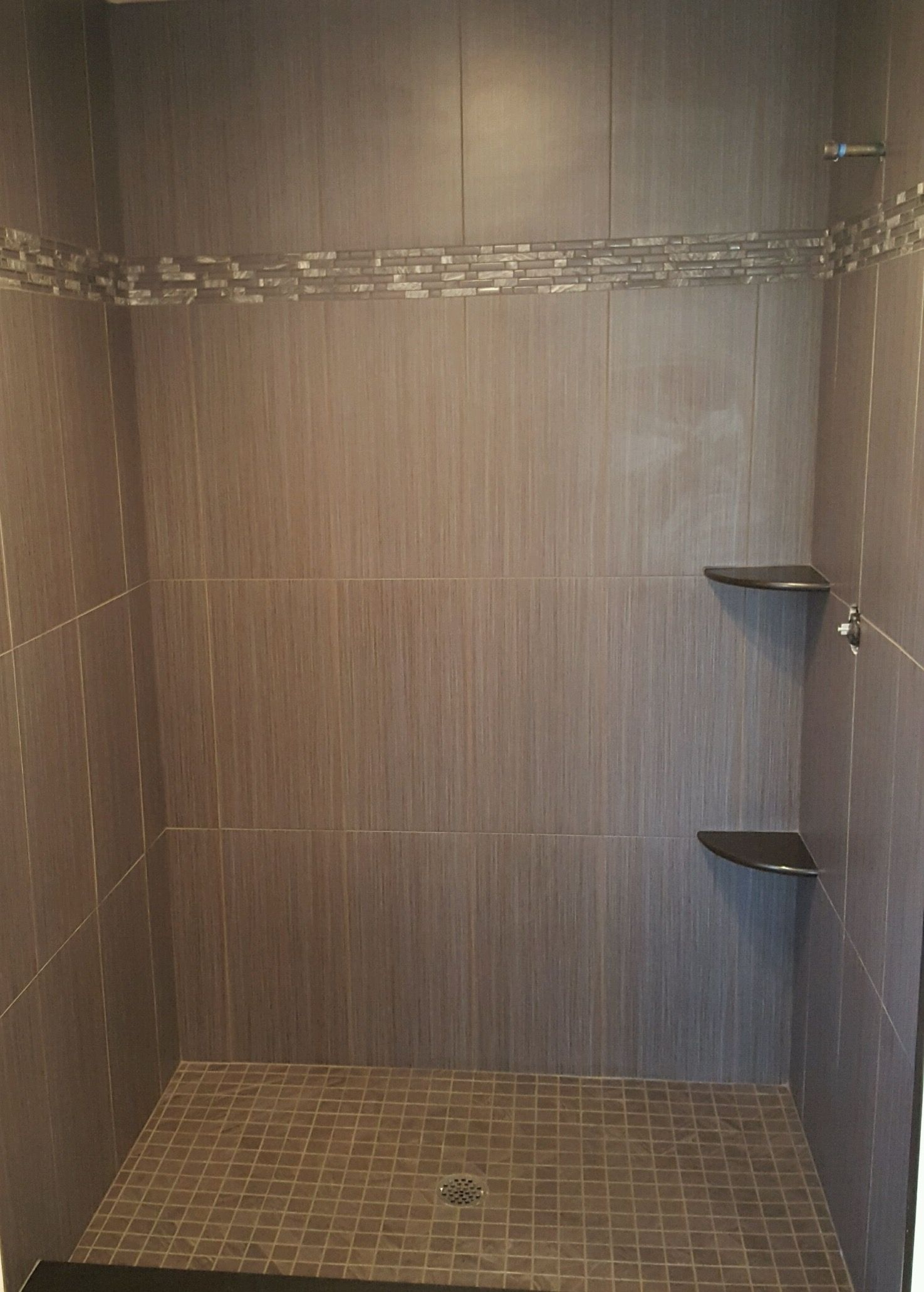 Grey ceramic tile in a shower done vertically with mosaic glass ...