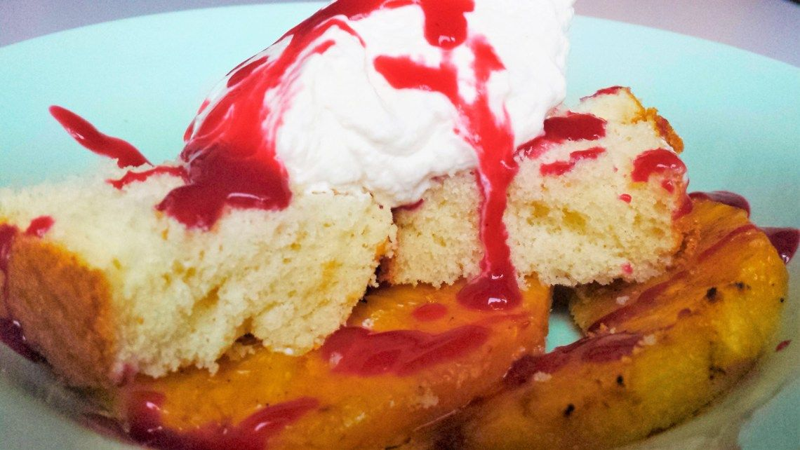 Grilled Pineapple Cake Bowl  Fluffy vanilla cake, sweet juicy pineapple, tangy raspberry sauce and a dollop of whipped cream - what more can you ask for?