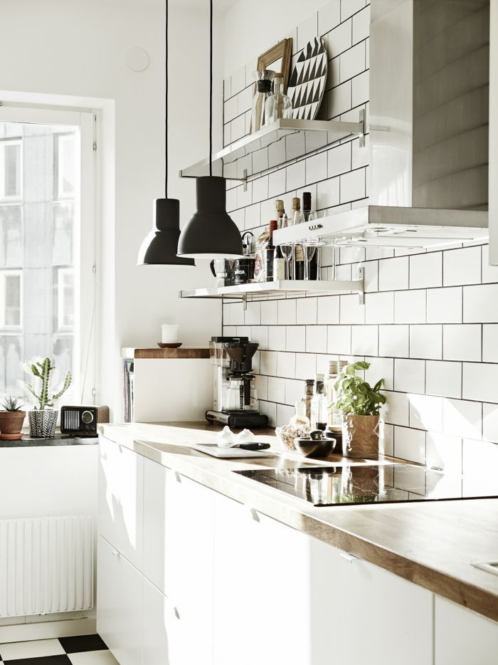 Nordic kitchen, stainless steel shelves and IKEA Hektar pendant