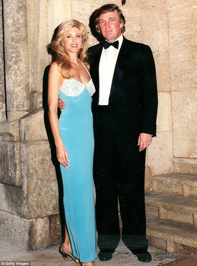 Portrait of married couple Marla Maples and businessman Donald Trump as  they pose together at the MaraLago estate Palm Beach Florida 1994