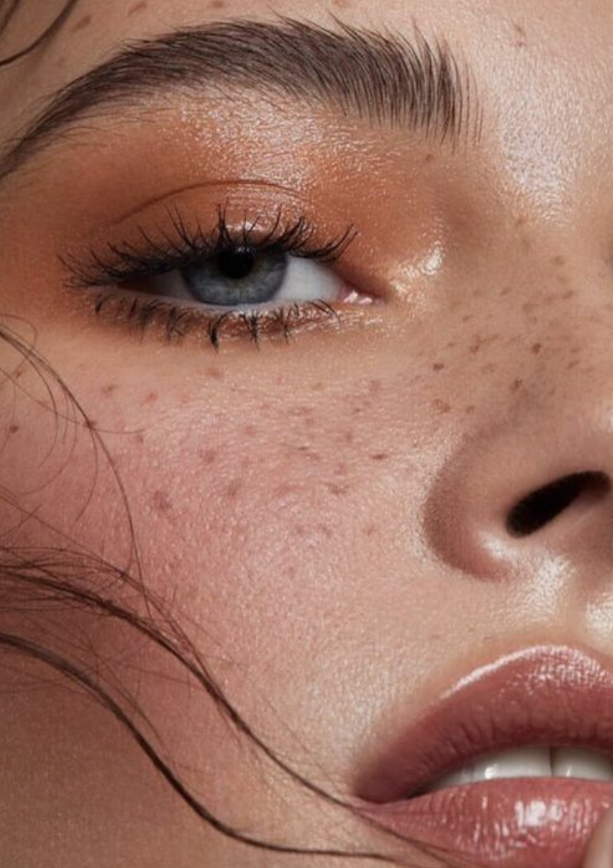 sunkissed makeup warm tone eyeshadow and fake freckle