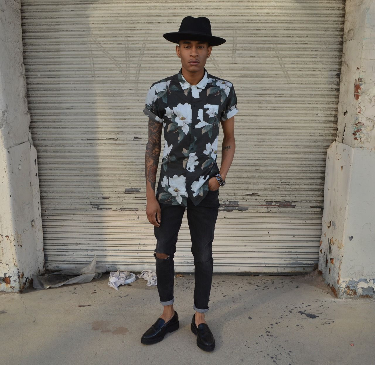 Shop this look on Lookastic:  http://lookastic.com/men/looks/black-and-white-shortsleeve-shirt-and-black-hat-and-black-skinny-jeans-and-black-loafers/2087  — Black and White Floral Short Sleeve Shirt  — Black Hat  — Black Skinny Jeans  — Black Leather Loafers