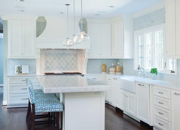 White And Turquoise Blue Kitchen Features Three Glass Pendants Illuminating A Wh Blue In 2020 White Kitchen Design Blue Backsplash Kitchen Kitchen Tiles Backsplash
