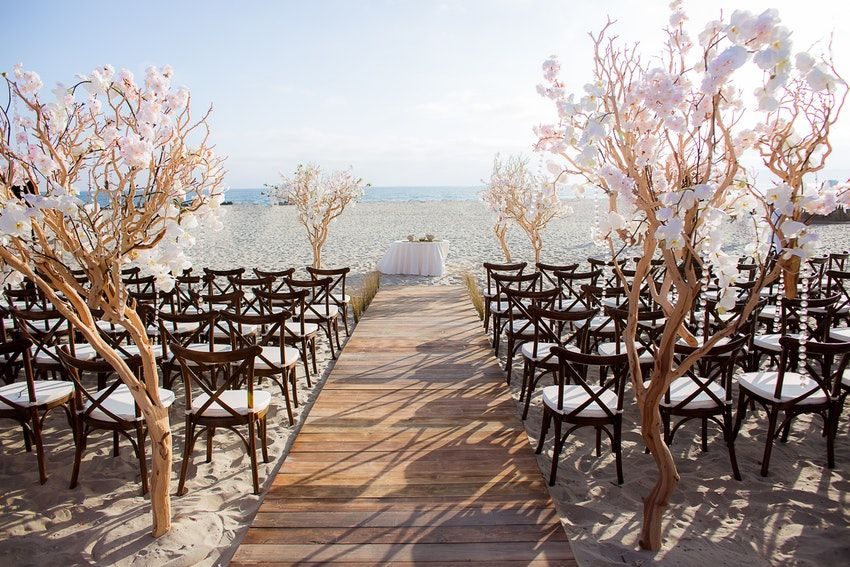 Beach Wedding Ceremony With Cherry Blossom Accents Venue
