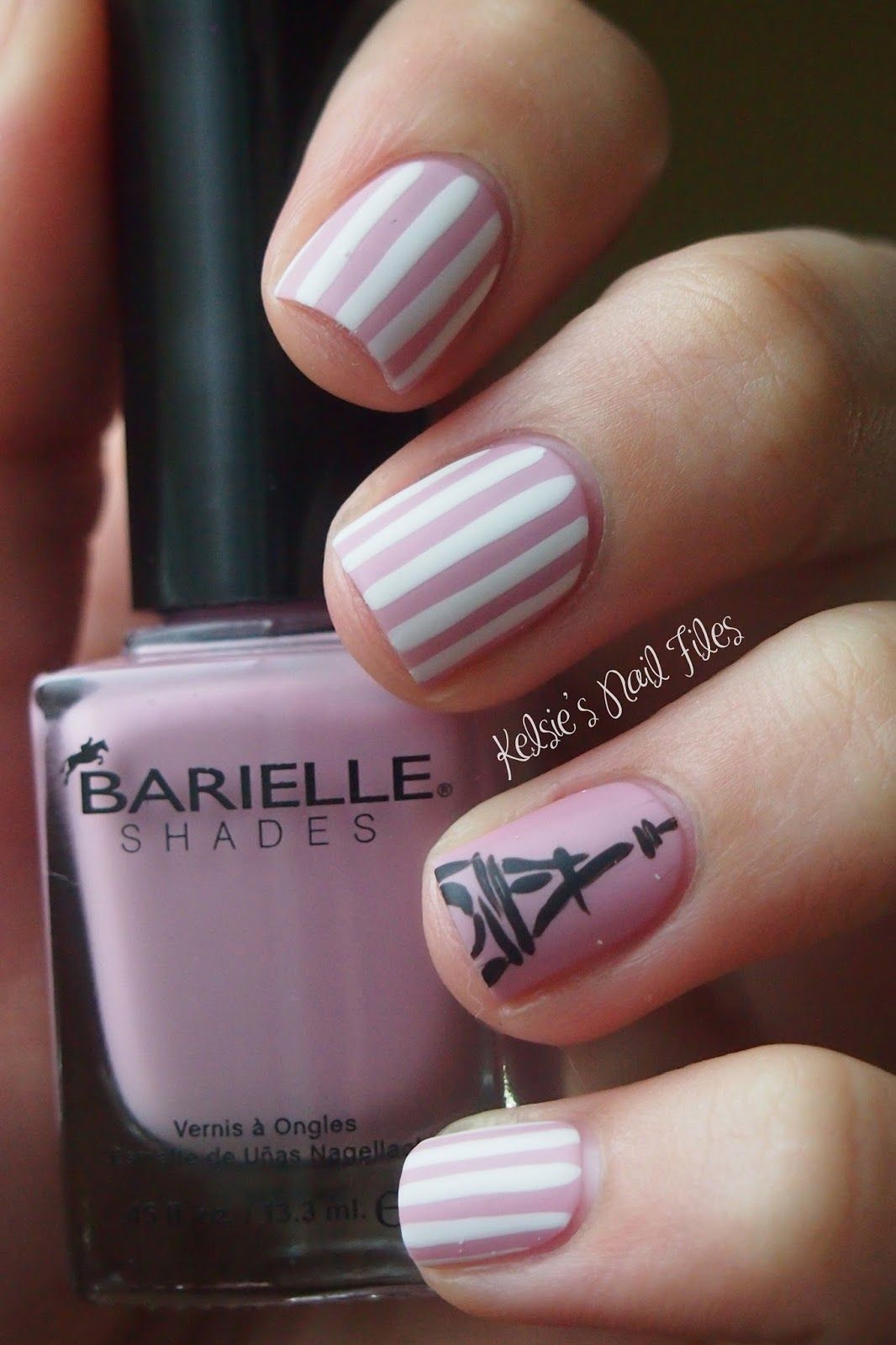 Nail Art using Pink and white stripes with Eiffel Tower accent ...