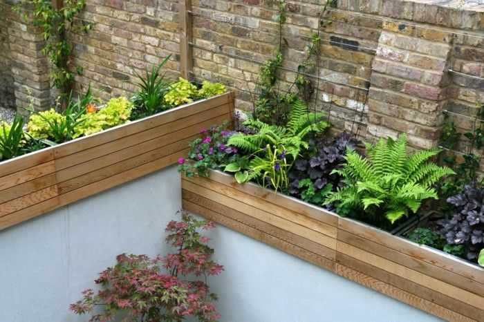 Small garden plant ideas 24 garden ideas for small gardens for Garden sectioning ideas