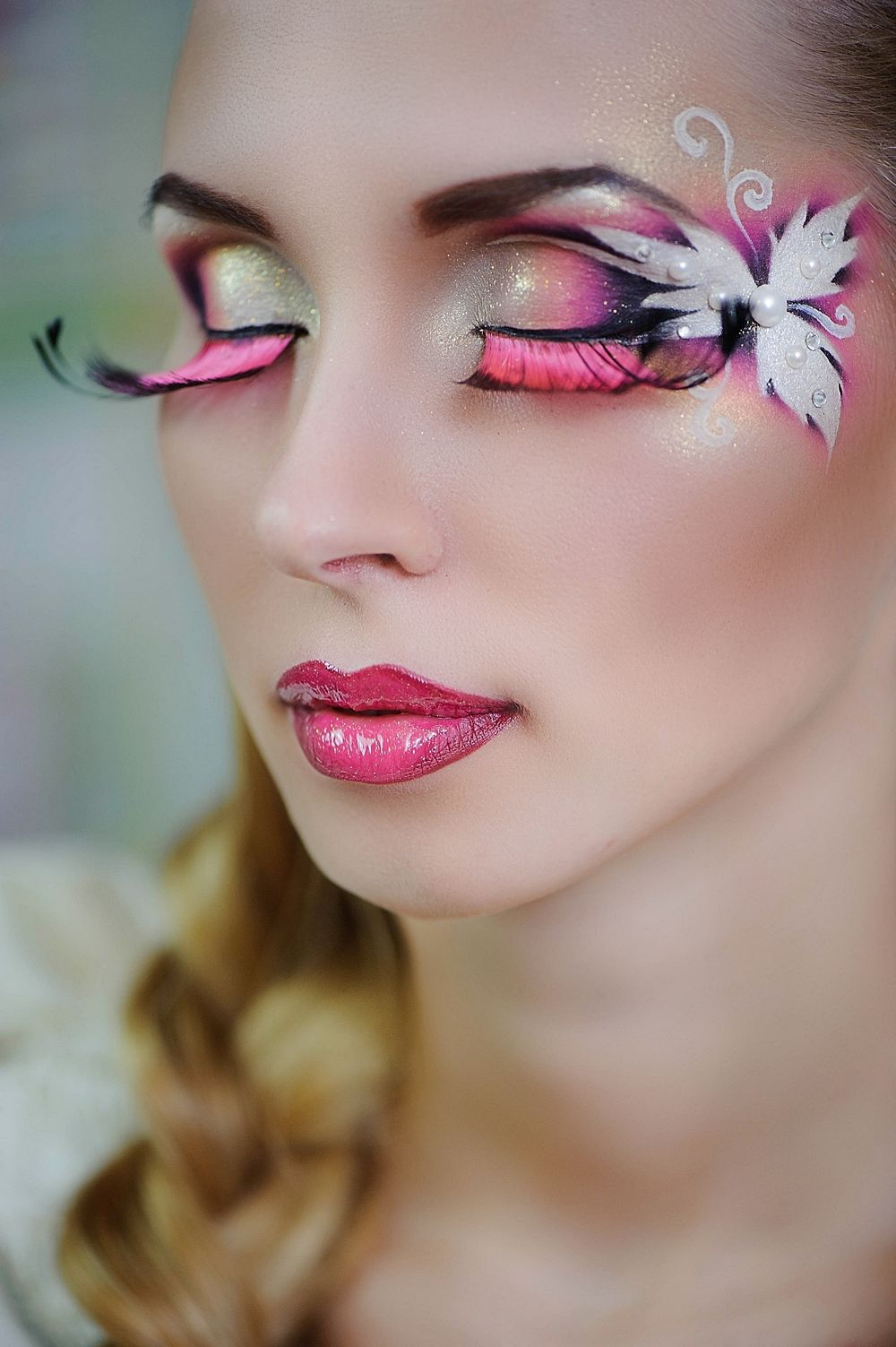 Artistic yellow, pink and white fantasy makeup with pink