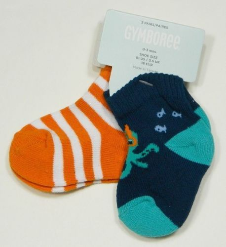 One package with two pair of socks.  One pair of socks is orange and white striped and the other pair is two shades of blue with an octopus image.
