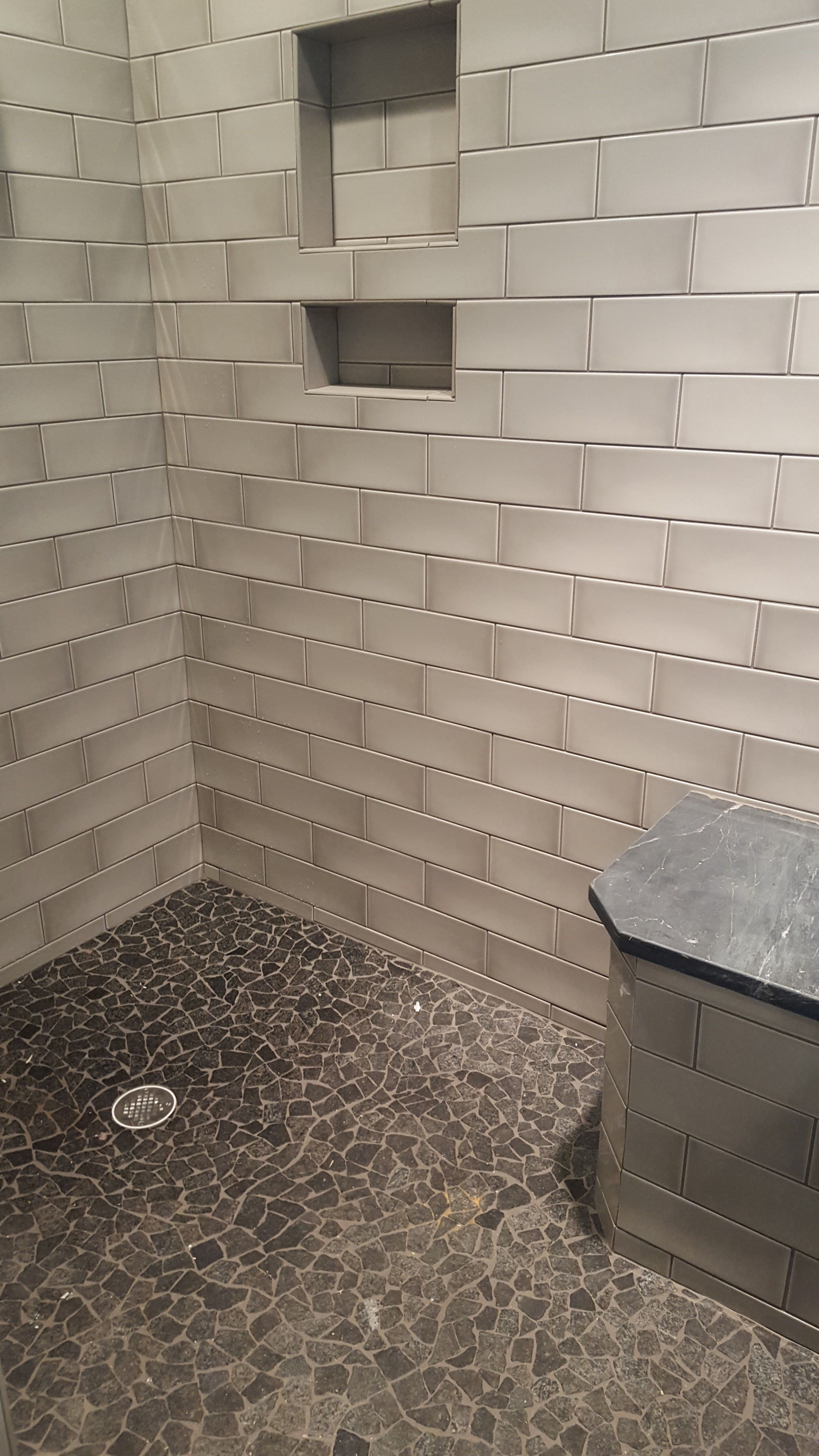 Fiandre 4x12 glossy wall tile french clay bronzage on walls and fiandre glossy wall tile french clay bronzage on walls and sides of seat shower floor is msi black pebbles and the shower seat is a leftover piece of the doublecrazyfo Gallery