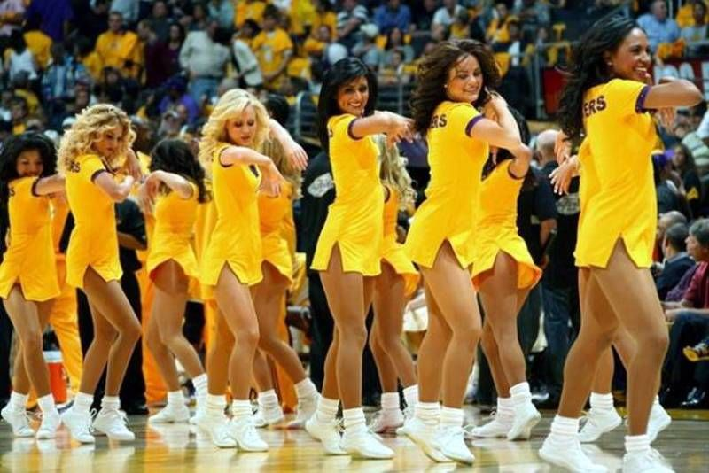 Laker Girls in yellow dress performing during game one of the NBA Finals