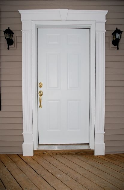 Front doors for homes doors this door also has a vinyl for Over door decorative molding