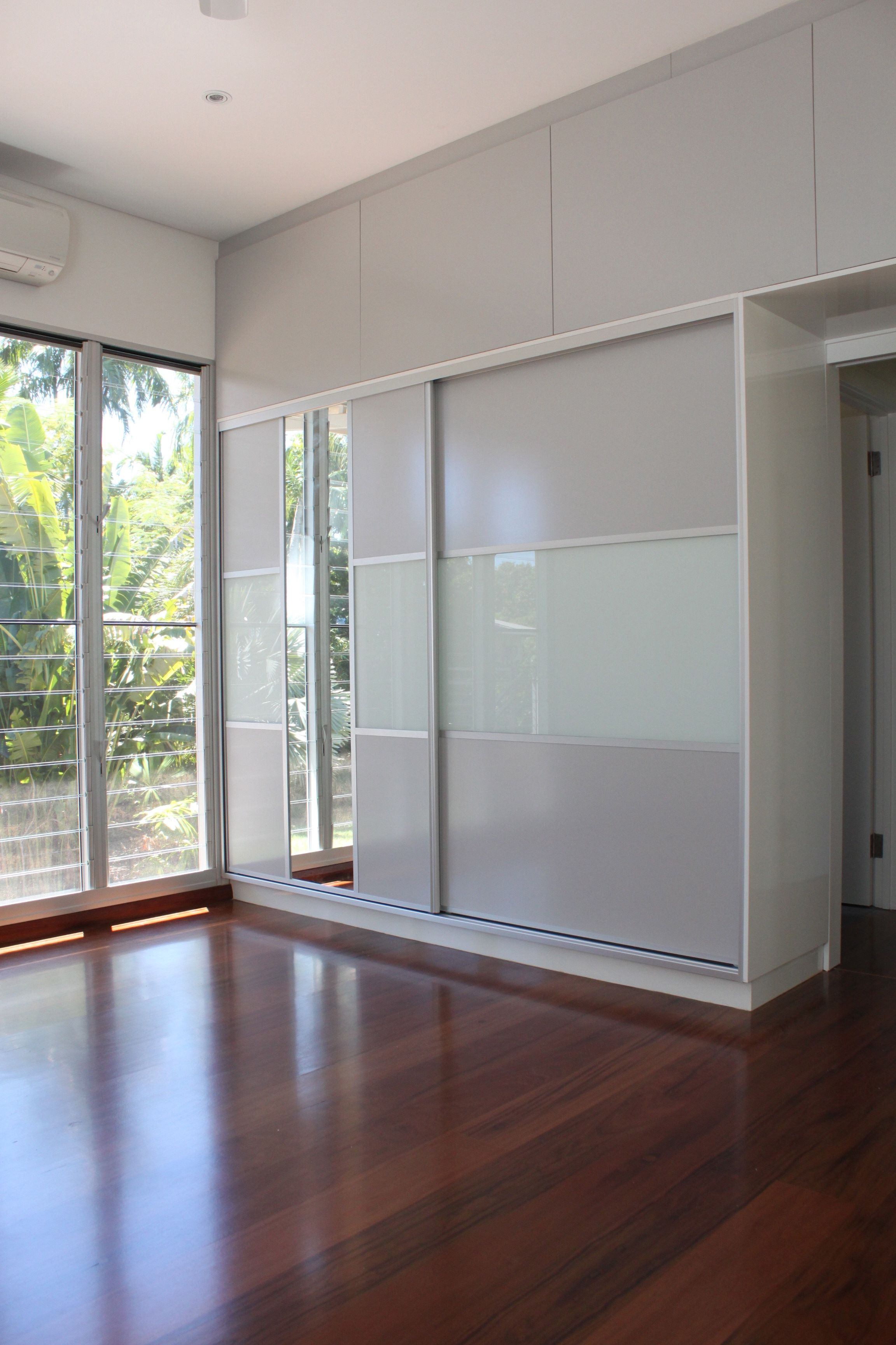 Sliding Closet Doors Design Ideas And Options: Panels Used In These Sliding Doors Compliment The Existing