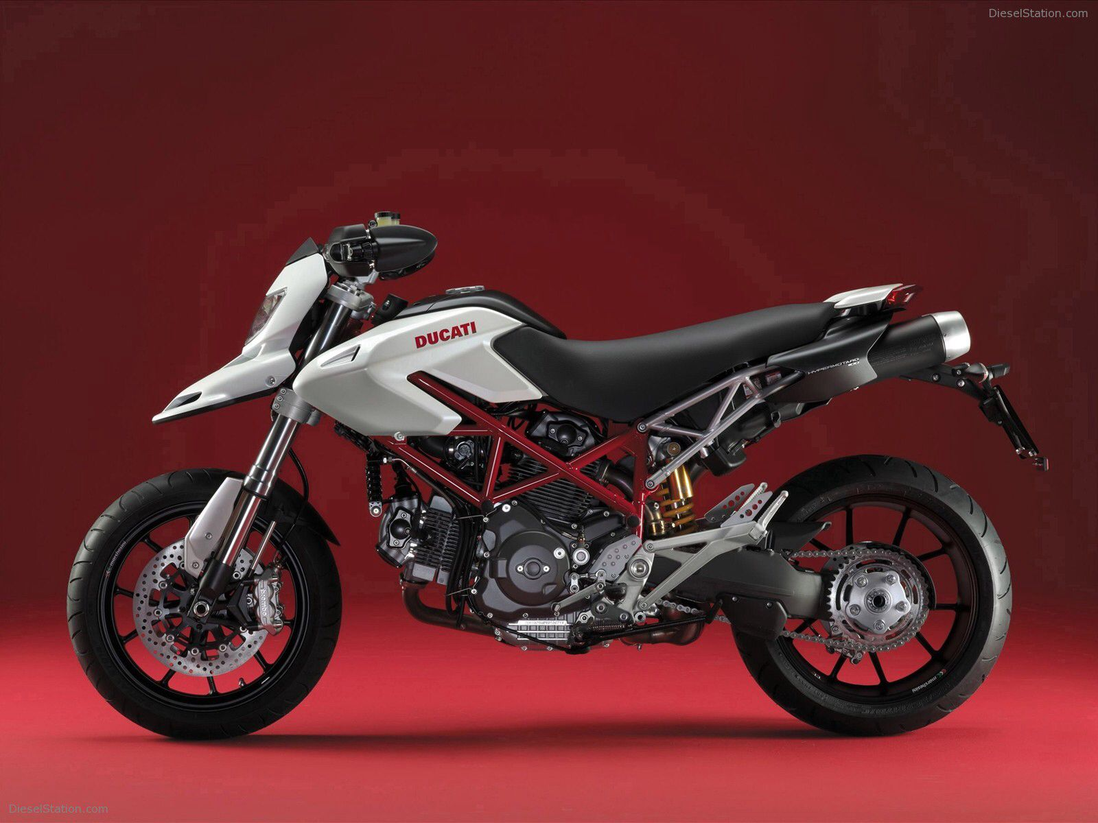 Image from http://www.dieselstation.com/wallpapers/albums/Ducati/New-pearl-white-livery/Ducati-New-pearl-white-livery-for-Ducati-Hypermotard-and-Multistrada-01.jpg.