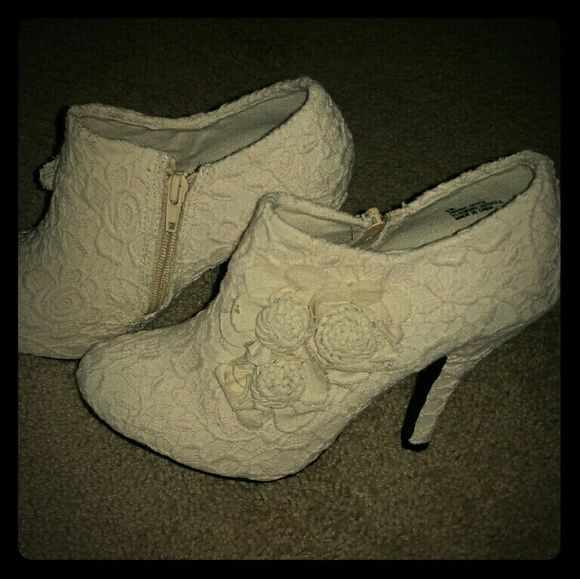 Beautiful Floral Crocheted Heel Ankle Booties Beautiful Floral Crocheted Heel Ankle Booties. I bought these beautiful heels from ModCloth for $59.99(and that was on sale) but they were just a little to small. I did not return them in time, and these are brand new never worn! ModCloth Shoes Ankle Boots & Booties