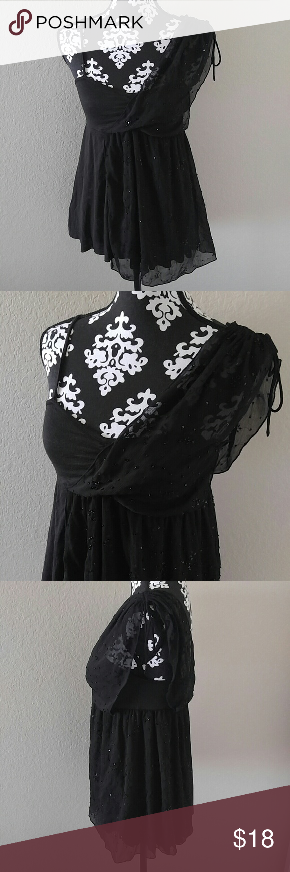 """Free People Embellished Top Free People spaghetti strap top? Adjustable straps? Sheer sequins overlay over left shoulder? Black? 100% polyester? Size XS? NWT- sales tag was removed but the baggie with extra sequins in still attached. The shirt is unworn?  Measurements laying flat NOT stretched:? Underarm to underarm: 13""""? Length: 26"""" Free People Tops"""