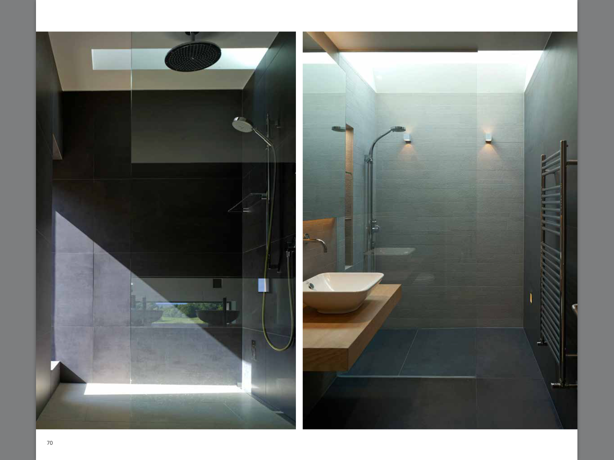 Walk in shower and black tiling