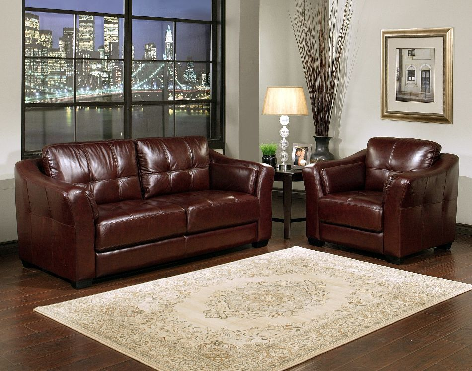 Dark burgundy leather sofa armchair set like the wall for Leather sofa family room