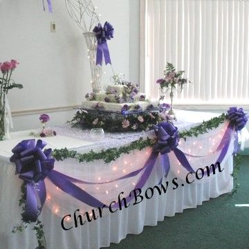 long table with bows & garlands