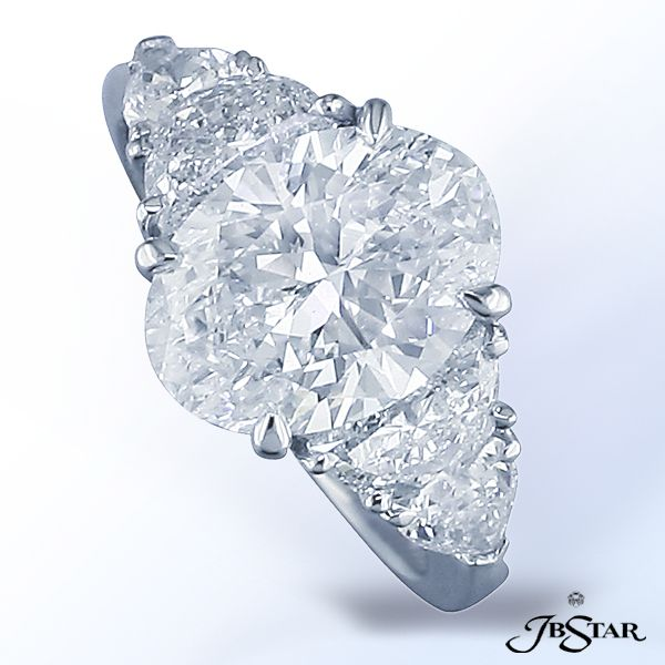 JB Star oval shaped diamond with shields and half moons.