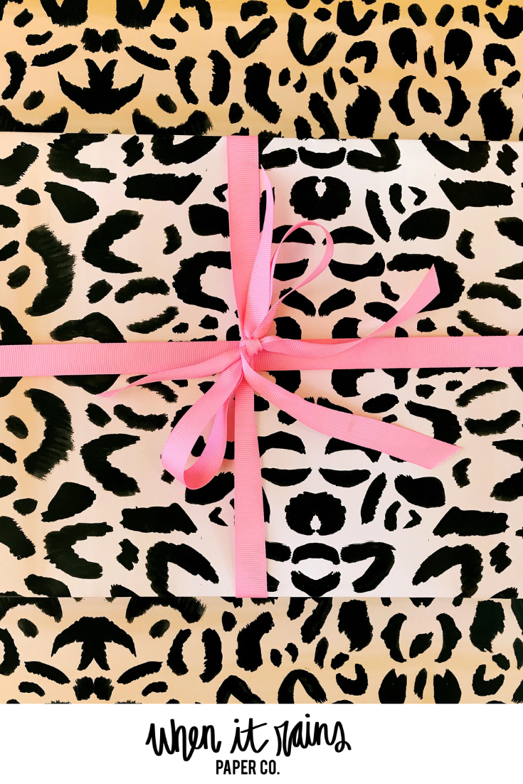 Our leopard gift wrap is the perfect addition to your party tradition! Designed by When it Rains Paper Co. #wrappingpaper #giftwrap #wrapstaratl #paperlove ...