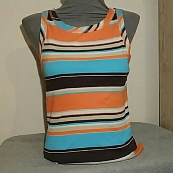 Cato multi color tank top It's in excellent condition  Only flaw is a very tiny spot  See last pic. Comes from a smoke free home Pet friendly home. Size small from cato fashion Cato Tops Tank Tops