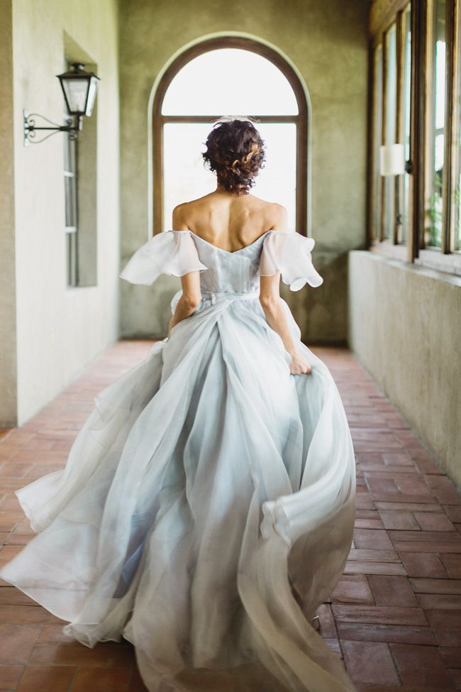This bridal portrait featuring Leanne Marshall\'s whimsical blue gown ...