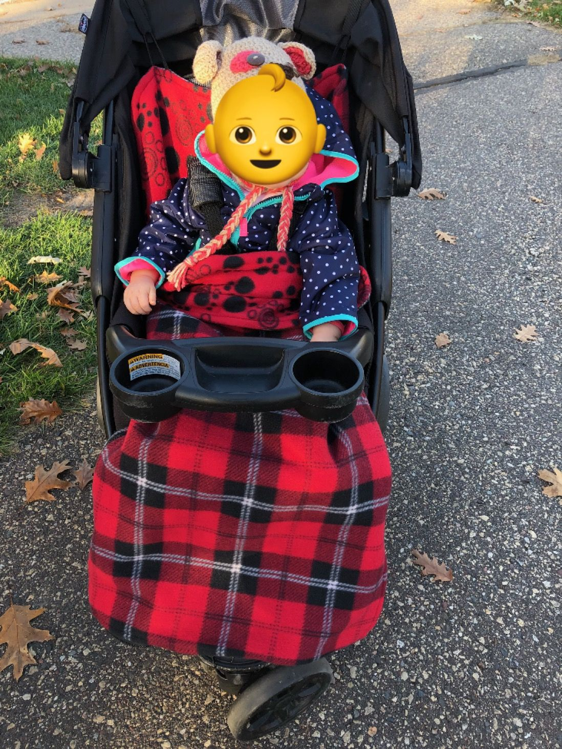 Baby stroller blanket that secures to stroller so child