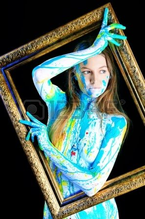 Art project: beautiful woman painted with many vivid colors...