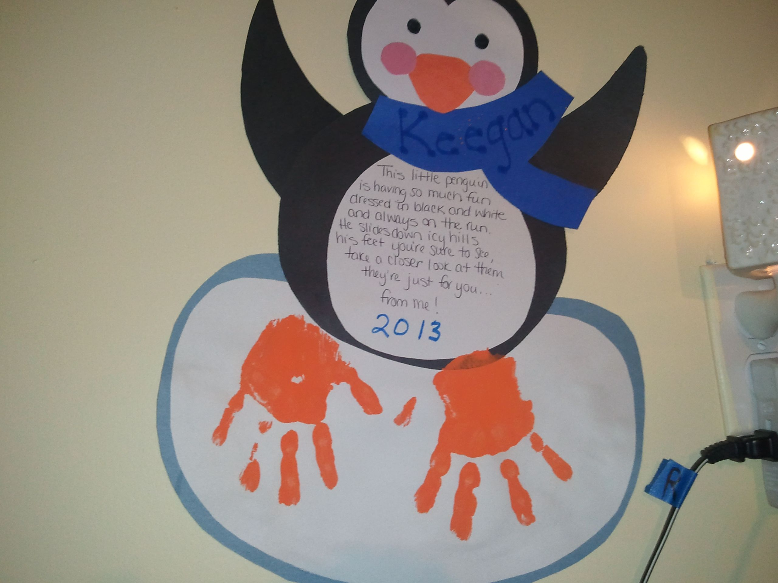 There is a second picture to this project that includes the poem.  Very cute wintery keepsake with kids handprints for penguin feet