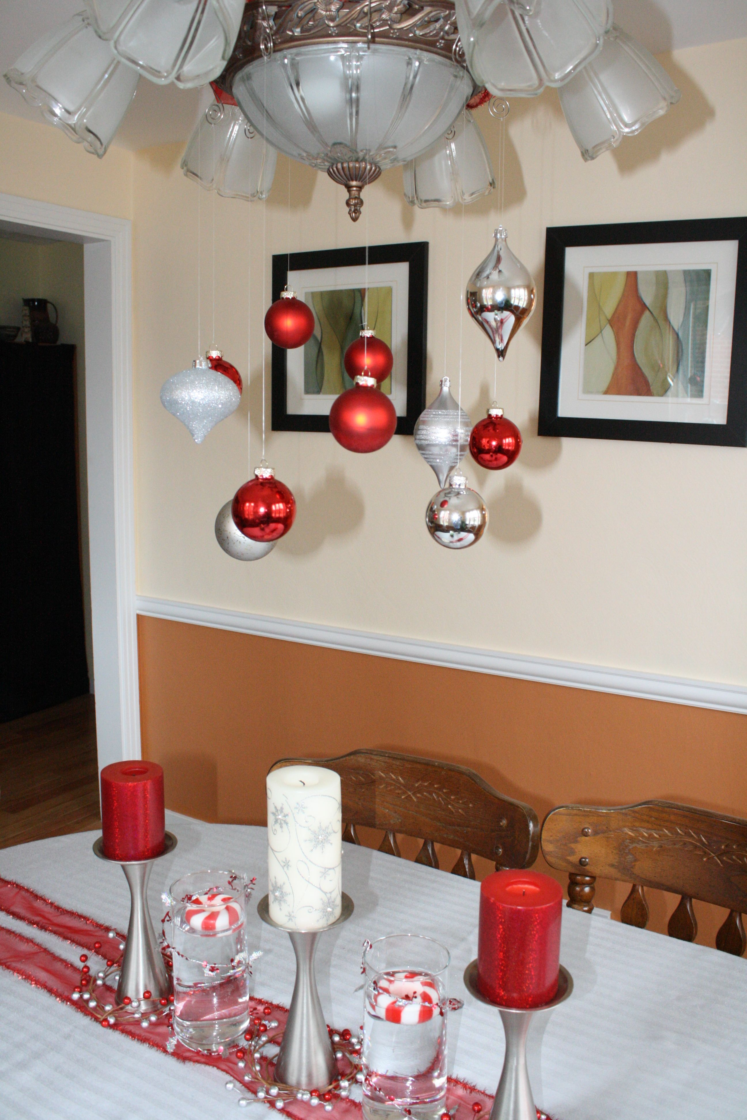 Chandelier and dining room table decorated with ribbon and ...