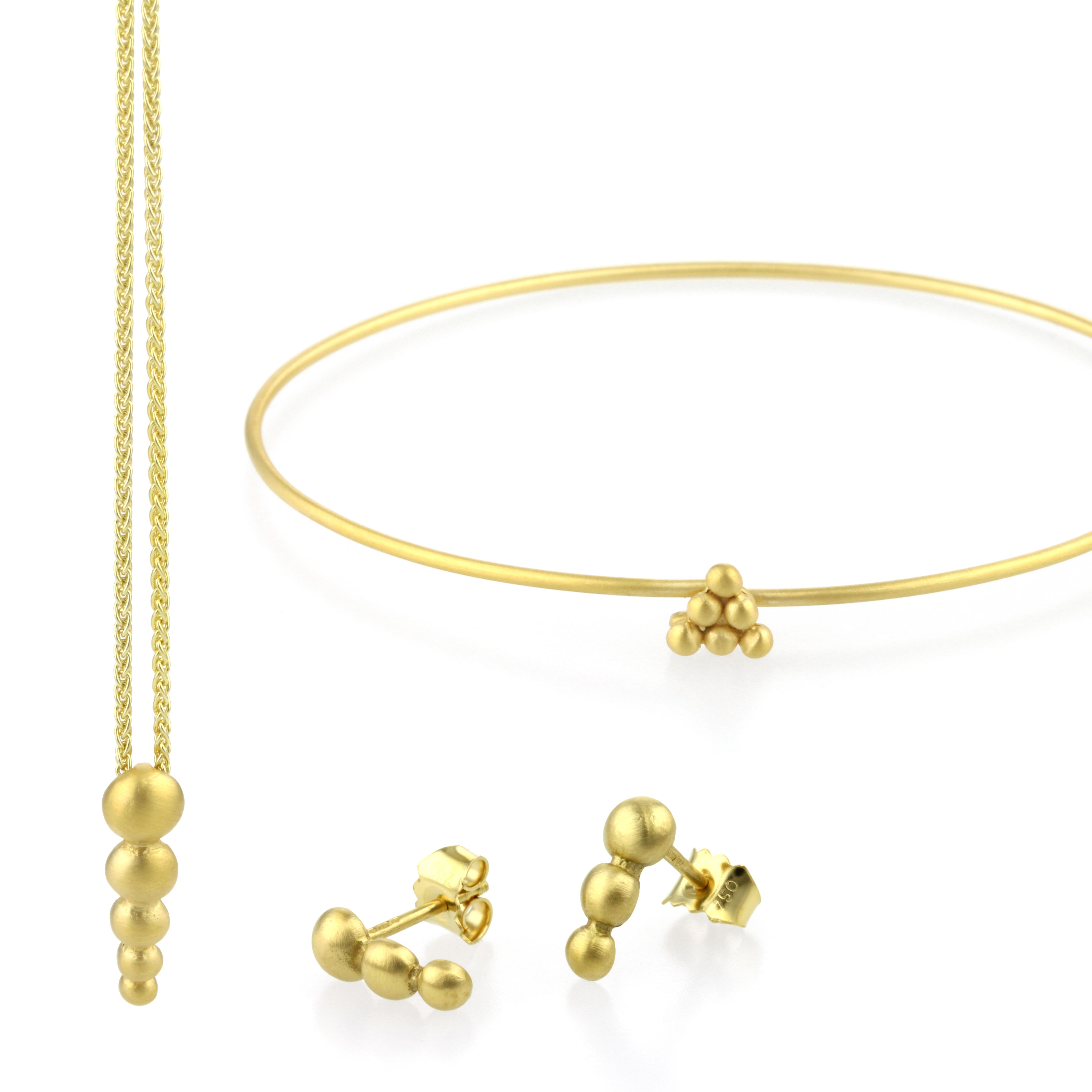 164c01e701a551 Visit us on stand S50. 18ct yellow gold #jewellery, inspired by our local  golden city of #Bath. SULIS earrings and pendants are handmade using  elegant ...