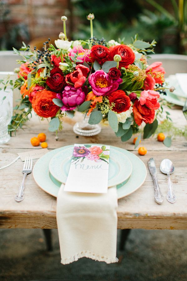 Eucalyptus leaves paired with bright flowers make a vibrant centerpiece.