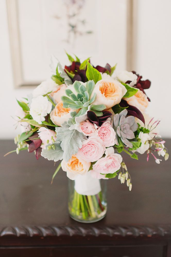 Peach, pink, cream, green and burgundy bridal bouquet with succulents, roses and jasmine.  Photo by Brown Butter Photography.  Flowers by Blum.