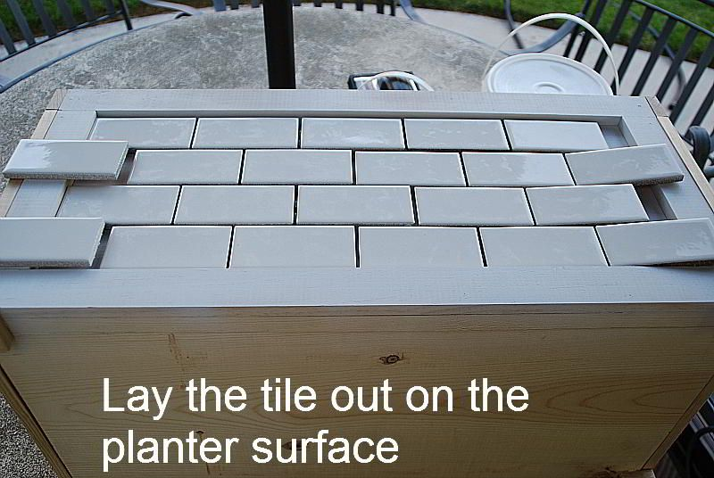 lay the tile out on the planter surface