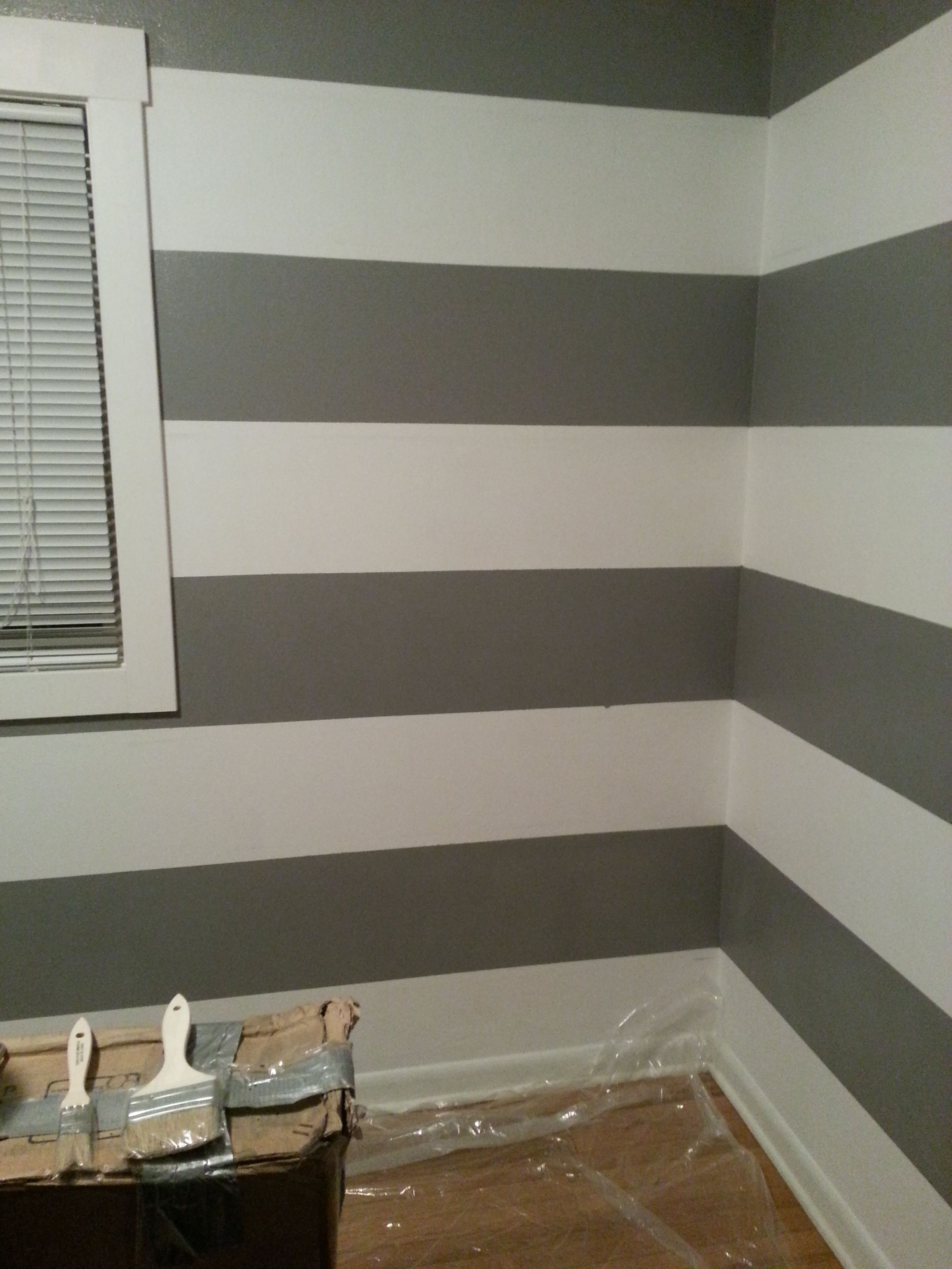 Grey and white striped walls in nursery